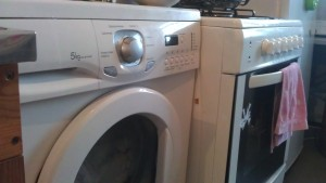 Our washer, next to sink and stove