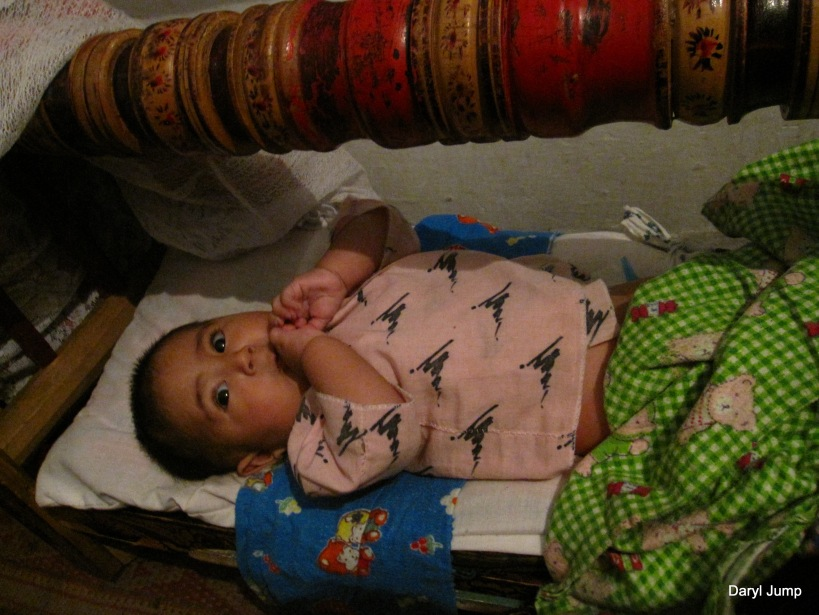 baby in a Central Asian Crib