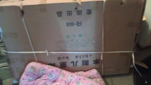 the delivered crib with mattress, pre-assembly